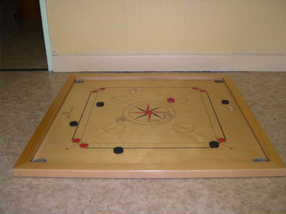Queen carrom